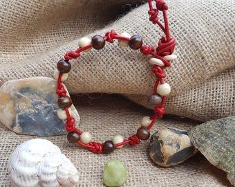 Red leather braided bracelet with wood beads.