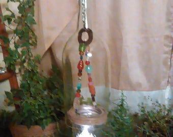 Cut bottle candle holder