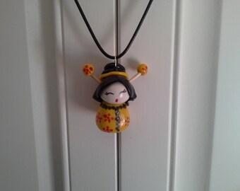 polymer clay and black cord kokeshi doll