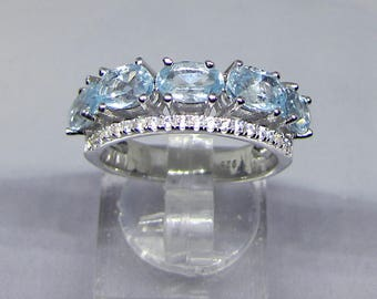Women's silver and Blue Topaz ring size 58