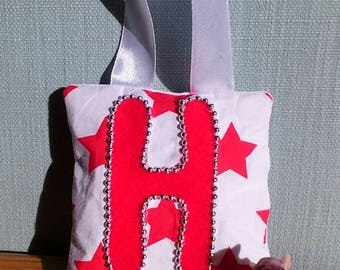 RED star tooth fairy pouch door-hanger with RED felt letter, SILVER beaded border, and red diagonal pocket on reverse for tooth/coin.