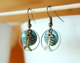 bronze fish and blue sequin earring