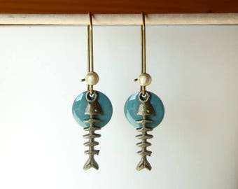 Enamelled sequin blue duck and fish bones pendant earring