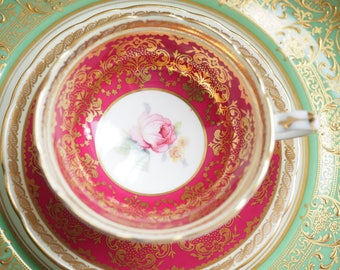 Vintage Paragon filigree gold red rose cup and saucer