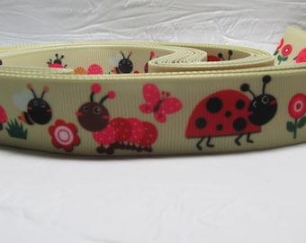 "Grosgrain ribbon 7/8"" ladybugs, flowers on beige/light brown sold by the yard"