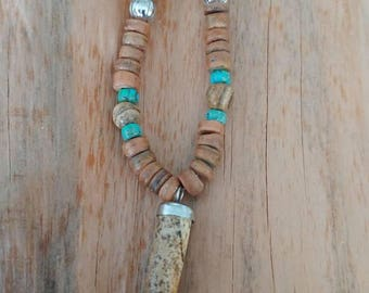 Necklace with bear tooth Jaspis gemstone, high quality blue glass beads, Jaspis beads and wooden beads.