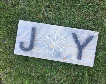 Joy with snowflake string art sign