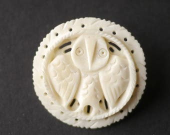 Carved ivorine (fake ivory) brooch with an owl