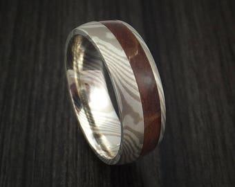 Palladium mokume gane ring with ancient kauri wood inlay custom made band