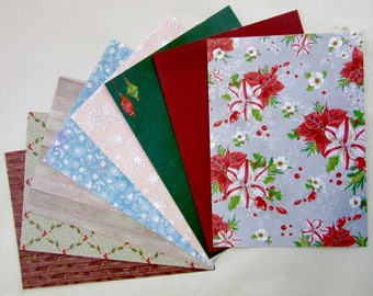 8 thick sheets of Christmas decorative paper