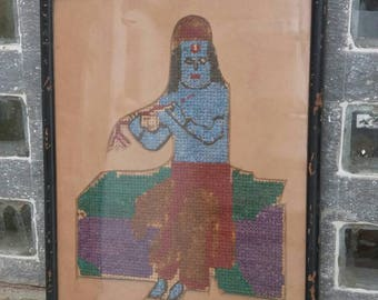An adorable wool vintage cross stitch tapestry of Lord Krishna playing his flute in a vintage frame Free shipping.