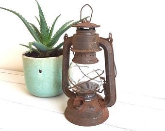 Old rustic storm lantern / oil lamp