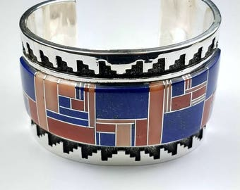 Vintage Native American Navajo handmade Sterling Silver channel inlay Coral and Lapis cuff bracelet by Tommy Jackson