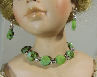 Elegant jade round flat beads and tibetin beads make this necklace and earring set very unique.  Handmade by Nims