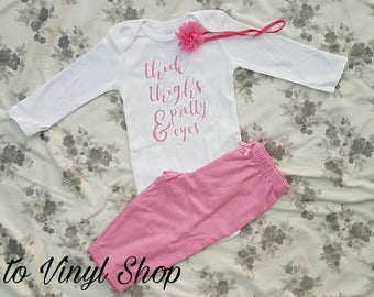 Thick Thighs And Pretty Eyes Baby Girl Onesie