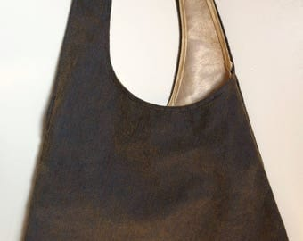 Royal blue iridescent fabric one shoulder bag/old gold lined in pale gold colour laminated cotton