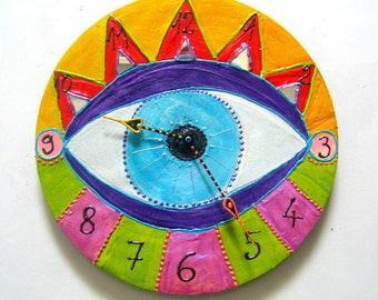 "Clock ""eye"" in acrylic paint and embossed - art singular diameter 33 cm"