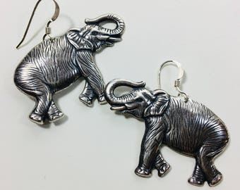 Beautiful Detailed Silver Plated Elephant Earrings by Ten Dollar Studio where all items are always Ten Dollars