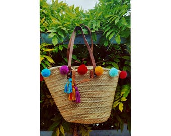 Bassinet basket has double handles decorated with tassels