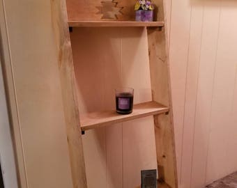 Rustic leaning shelving unit, bookcase