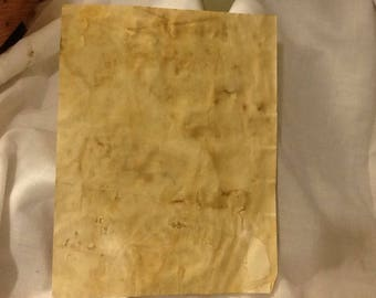 12 sheets of coffee stained paper