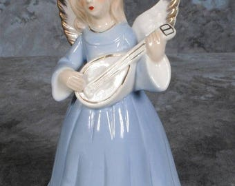 S Lady playing Enesco Violin music box