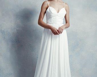 Paige / A-line wedding dress with deep sweetheart neckline, satin sash & court length train