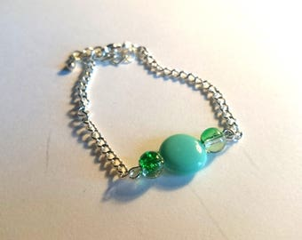 pretty simple bracelet with green flat bead