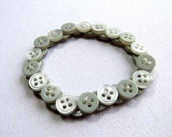 Pale grey upcycled button bracelet
