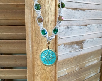 Boho beaded hemp necklace with green and golden glass beads and silver plated beads and compass rose pendant