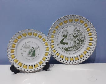 Two ribbon plates featuring Lewis Carroll Alice in wonderland, 2 vintage collectable/cabinet plates 1980's