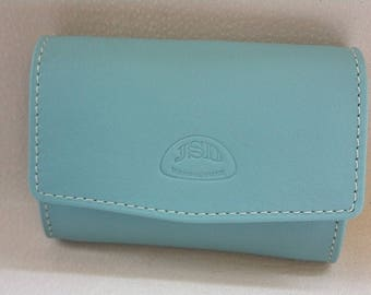 Coin purse in pastel blue leather: for coins and folded bills, more storage card front