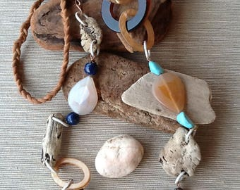 Necklace with semiprecious stones and lapis lazuli and small wood modelled by the sea.