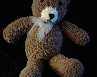 Hand knitted toy bear