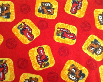 Flannel/Cars on red background cotton fabric by the yard