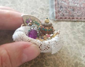 Miniature dollhouse basket of women's accessories, 1:12 scale.