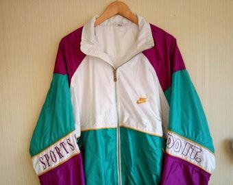 Vintage nike windbreaker women large Nike windbreaker men medium 90s nike jacket 90s nike windbreaker women Windbreaker nike vintage