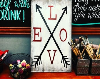 LOVE with a couple of arrows criss-cross VALENTINE'S DAY