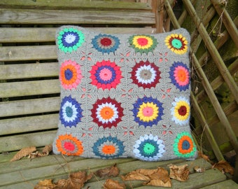 Crocheted granny square cushion cover