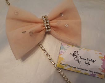 Gorgeous tulle net peach bow with glass diamantés