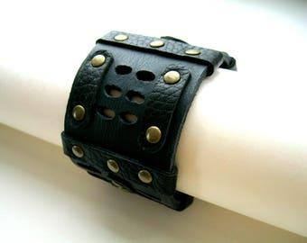 Black leather bracelet with metal rivets