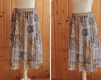 Vintage 1990s floral skirt / / small/size elastic //gaufree//mi-longue//made in France / / Pastel / /.