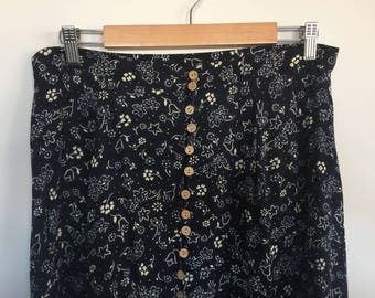 Navy and white floral maxi skirt. Button down front. M-L.