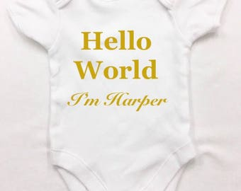 Hello world Personalised  bodysuit, with a soft gold glitter text