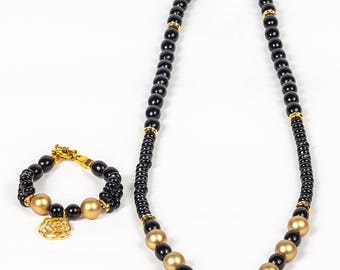 This necklace named Alex is.  Beautiful Necklace with Black and Gold beads