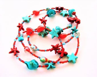 Long strand necklace, Seed beads, Crystal, Shell and Gemstones, Rondelle Beads in bronze, Natural tones. Turquoise and Vibrant Red.