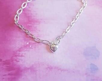 Silver heart chain linked bracelet.