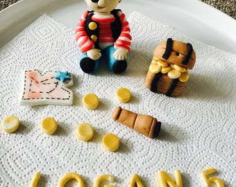 Edible pirates cake topper with name, age and decorations handmade from fondant