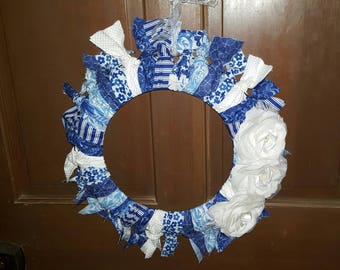 Blue and White fabric wreath with flower accents.