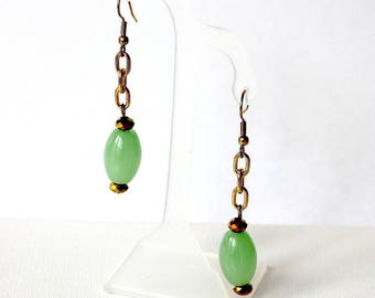 Gold chain and green oval earrings